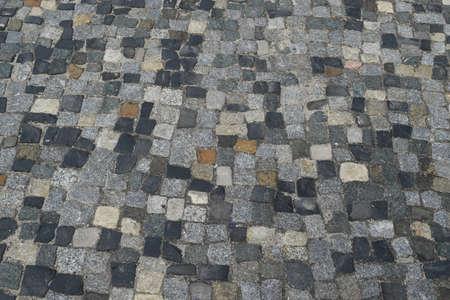 Portuguese Stone Pavement or Calcada Portuguesa Granite Cobblestone Road Top View. Mosaic Brick Cobblestoned Floor with Tiles and Small Stones Archivio Fotografico