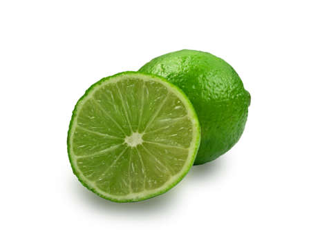 Sour key whole and sliced lime isolated on white background. Little juicy green lemon or fresh organic citrus with clipping path Standard-Bild