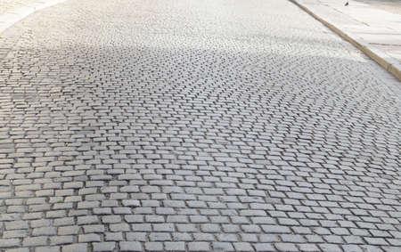 Grey Old Pavement Top View or Granite Cobblestone Road. Ancient Brick Cobblestoned Floor or Granite Tiles Street with Big Stones