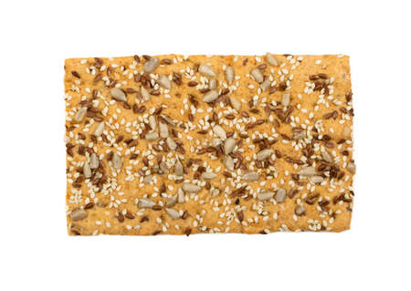 Crunchy gluten free crispbread with various seeds top view. Whole grain wheat crisp bread or cracker with sesame, sunflower and flax seed close up Stok Fotoğraf