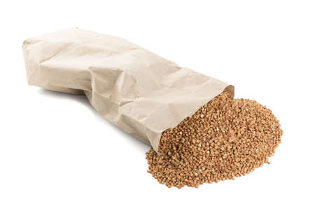 Dry Raw Buckwheat Grains in Paper Package Isolated on White Background. Russian Kasha or Uncooked Pseudocereal Buck Wheat in Plastic Pack Cut Out