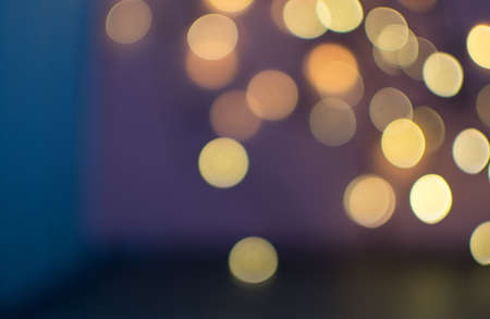 Abstract Background with Yellow Bokeh Circles. Beautiful Blurred Garland Night Lights Texture for Design