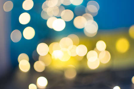 Blue Abstract Background with Yellow Bokeh Circles. Beautiful Blurred Garland Night Lights Texture for Stylish Party Design