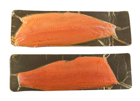 Salmon or Trout Fillet in Vacuum Packaging Isolated on White Background with Clipping Path Top View. Half of Red Fish in a Plastic Bag on a Gold Cardboard Substrate