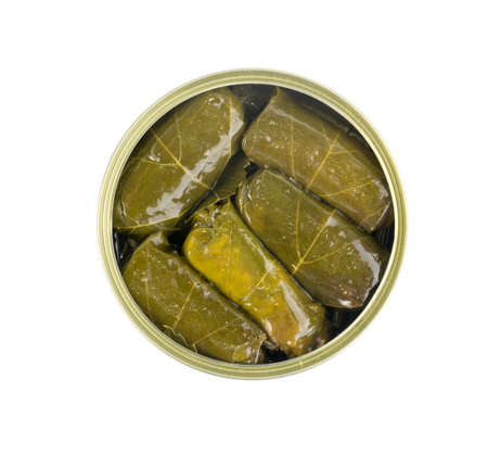 Canned Turkish Dolma, Sarma or Dolmades Isolated Top View. Traditional Mediterranean Dish Dolmadakia or Tolma Stuffed Grapes Leaves on Black Stone Background