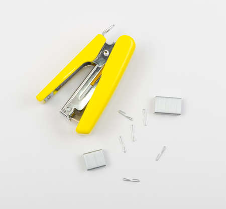 New Yellow Office Stapler on Side with Staples Isolated on White Background 免版税图像