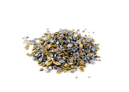 Gold and silver sprinkles isolated on white background top view. Sweet brown glaze decoration or chocolate vermicelli