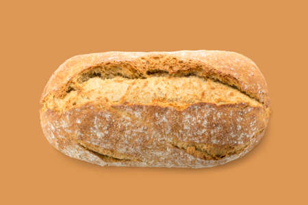 Homemade Freshly Baked Traditional Bread on Brown Background Top View. Whole Loaf of Rustic Organic Cereal Bread Made of Sourdough