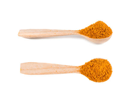 Mixture of Indian Spices and Herbs Powders with Cumin, Curry, Curcuma, Turmeric and Chilli Pepper. Orange Seasoning Powder Mix in Wooden Spoon Isolated on White Background Top View