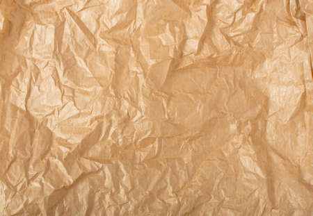 Crumpled Craft Paper Top View with Copy Space for Collages, Design and Montage. Empty Wrinkled Sheet of Brown Wrapping Old Paper Texture with Place for Text