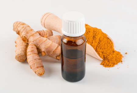 Indian Spices Oil and Herbs Powders with Cumin, Curry, Curcuma Root, Turmeric and Chilli Pepper. Orange Seasoning Powder Mix Essence Isolated on White Background