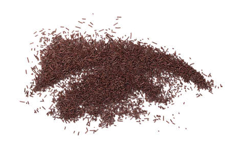 Chocolate sprinkles isolated on white background top view. Sweet brown glaze decoration or chocolate vermicelli Stock Photo