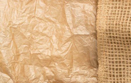 Crumpled Craft Paper with Burlap Top View with Copy Space for Collages, Design and Montage. Empty Wrinkled Sheet of Brown Wrapping Old Paper Texture with Place for Text