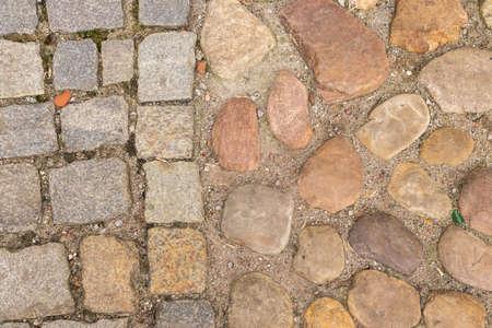 Old Brown Pavement Top View or Granite Cobblestone Road. Ancient Brick Cobblestoned Floor or Terracotta Granite Tiles Street with Big Stones