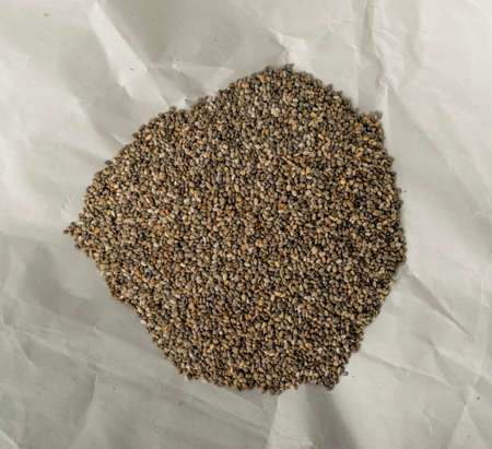 Pile of Chia Seeds in Wrapping Parchment Paper.
