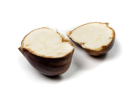Edible sweet white chestnuts core, healthy delicious autumn and christmas veggie food. Cut in half chestnut with white kernel isolated Stock Photo