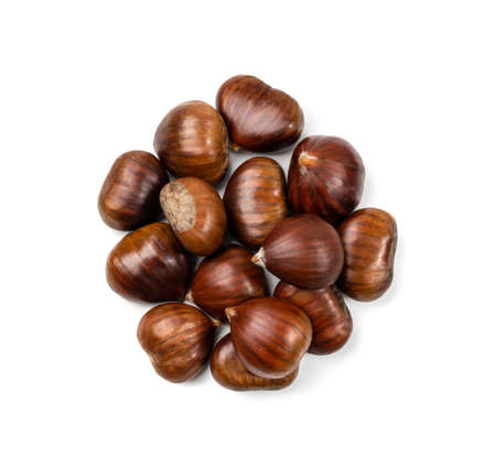 Group of edible sweet whole chestnuts isolated on white background. Raw healthy delicious chestnut, autumn and christmas european food top view Stock Photo