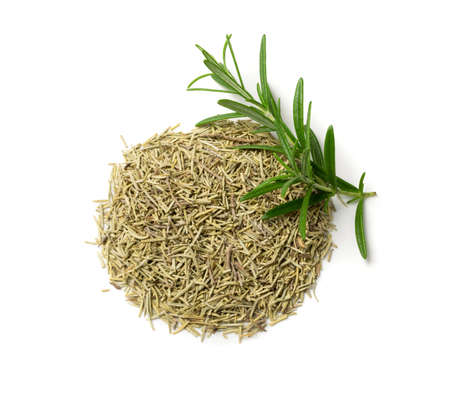 Neat round pile of dry rosemary needles isolated on white background. Dried crushed and fresh green rosemary leaves top view. Ground seasoning, herbs and spices