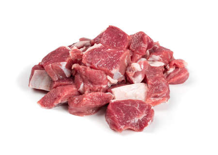 Raw chopped lamb fillet, diced tenderloin or cubed mutton sirloin meat isolated. Fresh sheep fillet cubes, loin filet for skewers Foto de archivo