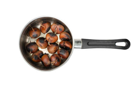 Grilled sweet whole chestnuts isolated on white background top view. Baked roasted healthy delicious chestnut, autumn and christmas veggie food