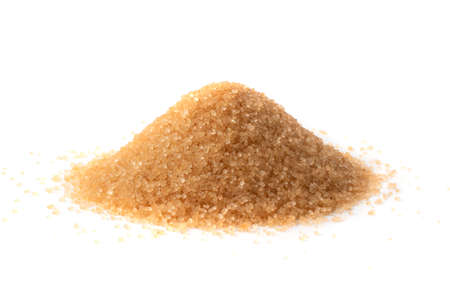 Pile of brown sugar isolated on white background. Raw unrefined cane sugar heap side view