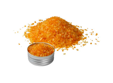 Heap of colorful bath salts isolated on white background side view. Aromatic orange salt crystals for body spa, bathing, beauty treatments, relaxation Reklamní fotografie