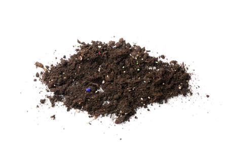 Soil contaminated with mineral fertilizers and microplastics isolated on white background. Isolated ground heap, dirt earth pile as earth pollution concept