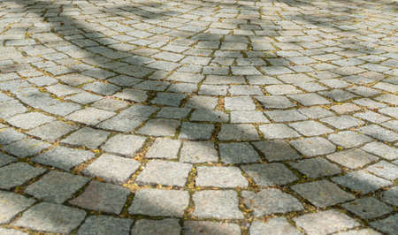 Grey Old Pavement Top View or Granite Cobblestone Road. Ancient Brick Cobblestoned Floor or Granite Tiles Street with Big Stones Archivio Fotografico