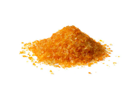 Heap of colorful bath salts isolated on white background. Aromatic orange salt crystals for body spa, bathing, beauty treatments, relaxation