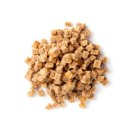 Pile of homemade rye bread croutons isolated on white background top view. Crispy bread cubes, dry rye crumbs, rusks, crouoton or brown roasted crackers cube heap Stock fotó