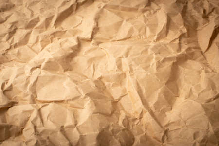 Wrinkled Kraft Paper Texture, Packaging, Wrapper. Natural Brown Vintage Paper Background.