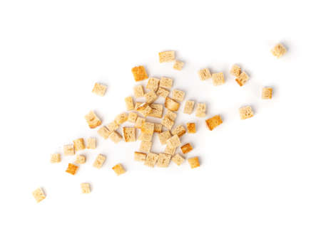 Bread croutons splash isolated on white background top view. Crispy bread cubes, dry crumbs, rusks, crouoton or white roasted crackers cube heap Stock fotó