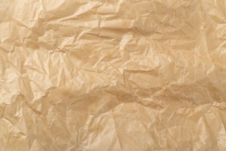 Sheet of Brown Thin Crumpled Craft Paper Parchment Background Top View. Wrinkled Tan Wrapping Paper Texture or Pattern Stock fotó