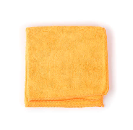 Folded Orange Microfiber Cleaning Cloth Isolated on White Background Top View Closeup