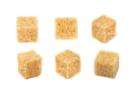 Raw brown sugar cubes set isolated on white background. Unrefined cane sugar cube collection