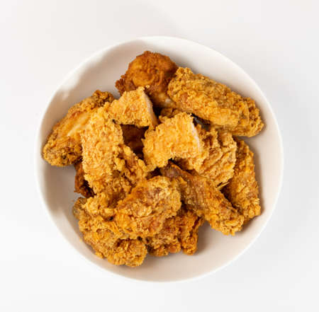 Breaded Fried Chicken Wings, Fingers and Drumsticks Isolated on White Background Top View. Hot Crispy Chicken Nuggets, Fillet Strips, Meat Pieces in Breadcrumbs