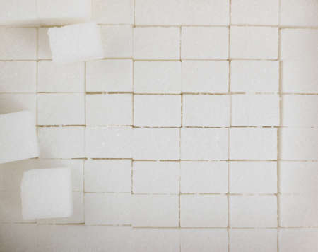 White sugar cubes textured background top view. Refined white sugar cube pattern with copy space