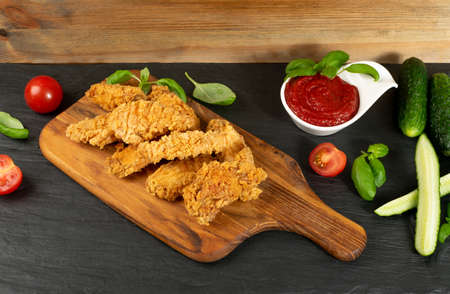 Breaded Deep Fried Fish Nuggets on Wooden Rustic Background. Hot Crispy White Fish Boneless Pieces and Shrimps in Breadcrumbs 스톡 콘텐츠