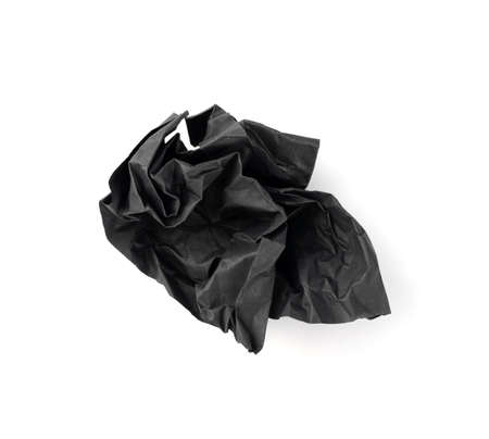 Crumpled Black Paper Ball Isolated on White background. Natural Textured Wadded Up Scrunched Sheet. Crumpled up dark paper ball
