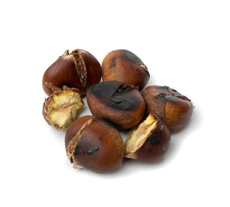 Grilled sweet whole chestnuts isolated on white background. Baked roasted healthy delicious chestnut, autumn and christmas veggie food
