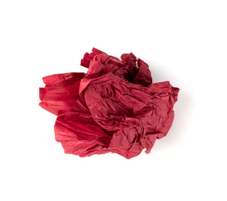 Crumpled Tissue Paper Ball Isolated on White background. Red Wadded Up Rolling Cigarette Paper. Crumpled Up Crimson Tracing Paper Page Ball
