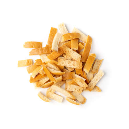 Heap of Bread Crusts Isolated on White Background Top View. Crushed Rusk Bread Crusts, Degradable Waste Ingredient