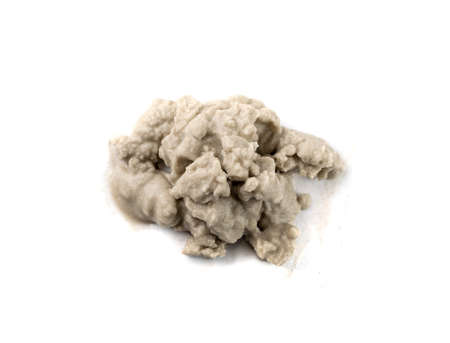Heap of wet sea sand top view. Dripping sandy beach textured pile isolated on white background