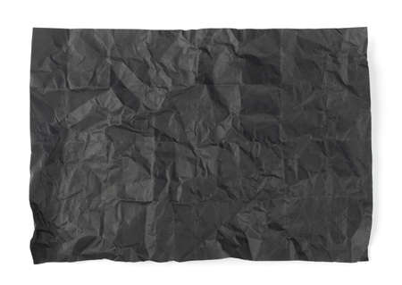 Folded Crumpled Black Paper Texture Background. Dark Wrinkled Rolling Paper Sheet Pattern with Copy Space. Creased Page Wallpaper