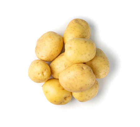 Raw whole potato pile isolated on white background top view. Yellow washed bio potatoes Stock Photo