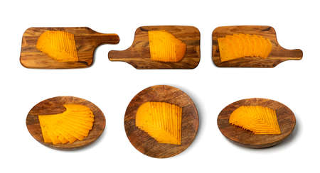 Orange hot cheese with chili pepper and paprika. Sliced cheese with herbs and spices on cutting board and wooden plate isolated top view