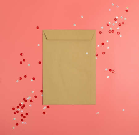 Christmas Decorations Mockup with Blank Vintage Envelope Top View. Red Xmas Background with Copy Space