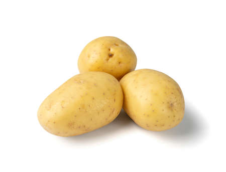 Raw whole potato pile isolated on white background top view. Yellow washed bio potatoes