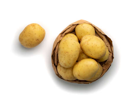 Raw whole potato pile isolated on white background top view. Yellow washed eco bio potatoes in paper bag mockup