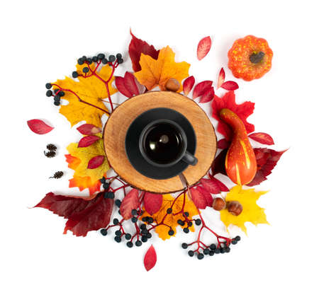 Autumn coffee concept. Cup of coffee composition top view and flat lay isolated on white background. Fall hot drink with yellow and red leaves, autumn morning tea